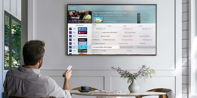 Man watching Samsung QNED television